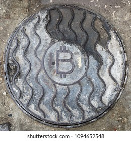 Bitcoin symbol on the hatch cover