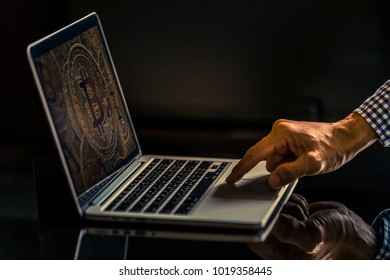Bitcoin trading concept, Hand of casual business man using laptop.