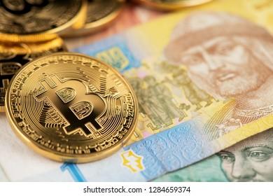 Bitcoin and Ukraine national currency Bitcoins with Ukraine money hryvnya on background Ukrainian hryvnia money with bitcoins bitcoin with Ukrainian money closeup background of Ukraine hryvnia