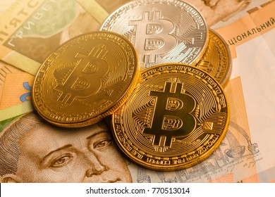 Bitcoin and ukraine national currency hryvnya on background