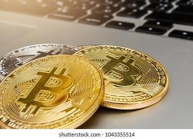 Bitcoin upright on a laptop keyboard