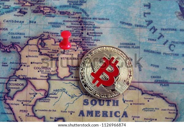 Bitcoin in Venezuela on world map. Venezuela is the cheapest country to mine bitcoin. Mining of bitcoin in Venezuela concept.