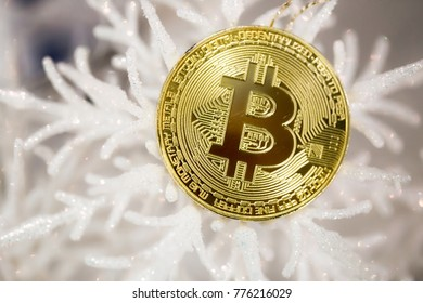 Bitcoin virtual crypto currency symbol and Christmas lights