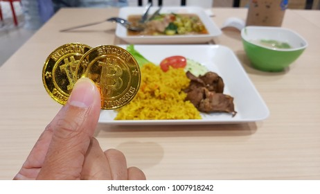 Bitcoin, Virtual Digital money coin and blur food plate in food court background. Virtual money with trading in the real world concept.