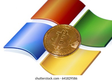 bitcoin and windows background. Windows is a operating systems developed, marketed, and sold by Microsoft. Ufa, Russia - May 17, 2017