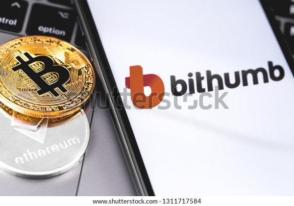 bitcoins, Bithumb logo of crypto-exchange on the screen smartphone. Bithumb is popular largest cryptocurrency exchange on the market. Moscow, Russia - February 13, 2019