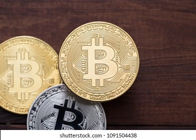Bitcoins (BTC) cryptocurrency coins over   wooden background,  business concept