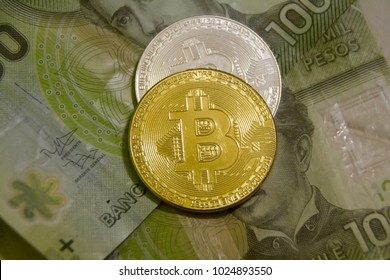bitcoins and chilean money pesos. symbolic coins of bitcoin on banknotes of Chile. Exchange bitcoin cash for a peso.