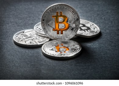 bitcoins coins on a black background. bitcoin is the most popular cryptocurrency in the world.
