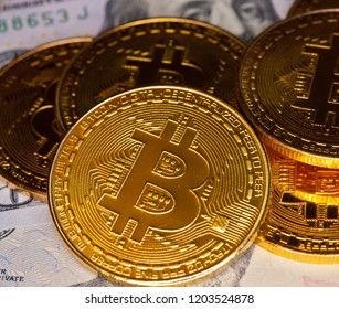 Bitcoins (Cryptocurrency) and 100$ (United States dollars bills)