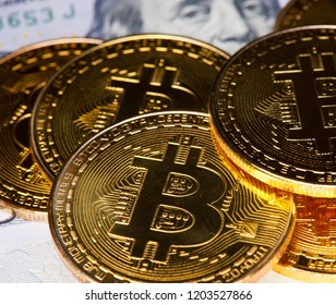 Bitcoins (Cryptocurrency) and dollars - United States one hundred-dollar bill ($100)