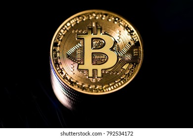 Bitcoins with a dark background.