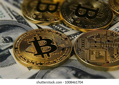 Bitcoins and dolalrs on table