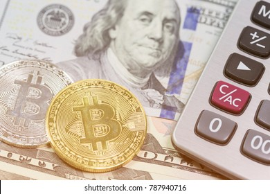 Bitcoins and dollars with calculator in background