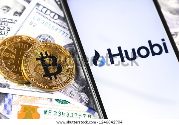 bitcoins, dollars and Huobi logo on the screen smartphone. Huobi - one of the largest cryptocurrency exchange on the market. Moscow, Russia - December 1, 2018