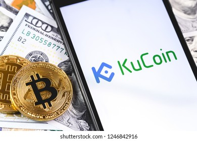 bitcoins, dollars with KuCoin logo on the screen smartphone. KuCoin - one of the largest cryptocurrency exchange on the market. Moscow, Russia - December 1, 2018