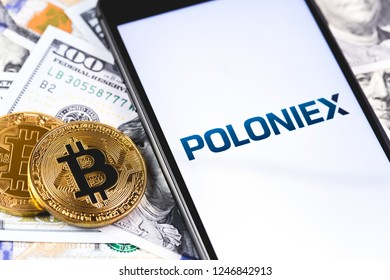 bitcoins, dollars and Poloniex logo on the screen smartphone. Poloniex - one of the largest cryptocurrency exchange on the market. Moscow, Russia - December 1, 2018