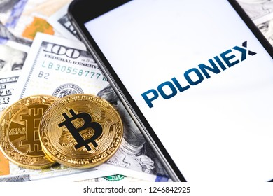 bitcoins, dollars with Poloniex logo on the screen smartphone. Poloniex - one of the largest cryptocurrency exchange on the market. Moscow, Russia - December 1, 2018