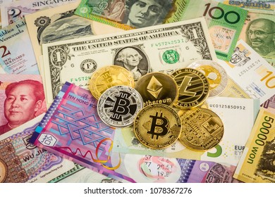 Bitcoins, ethereum, litecoin, ripple, cryptocurrency set on worldwide banknotes. Concept of electronic money, financial and business investment.