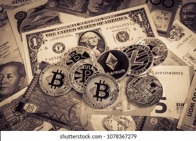 Bitcoins, ethereum, litecoin, ripple, cryptocurrency on worldwide banknotes, vintage filter. Concepts of electronic money, currency exchange and economic crisis.