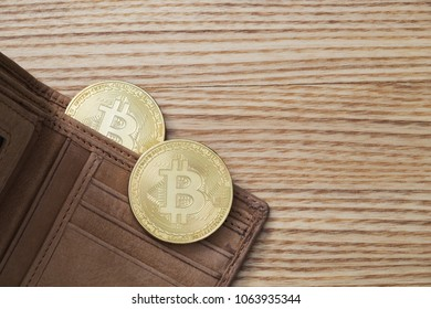 bitcoins in leather waller