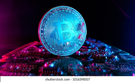 Bitcoins - the new modern currency for bitcoin payments - close up shot