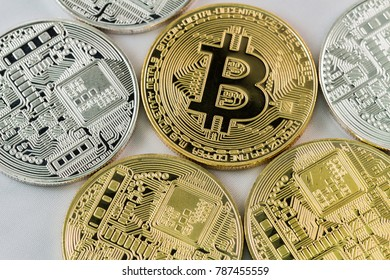 Bitcoins and New Virtual money concept.Gold and silver coins for business sell and trade. Bit coin Mining or block chain technology for crypto currency. Modern electronic money for virtual exchange.