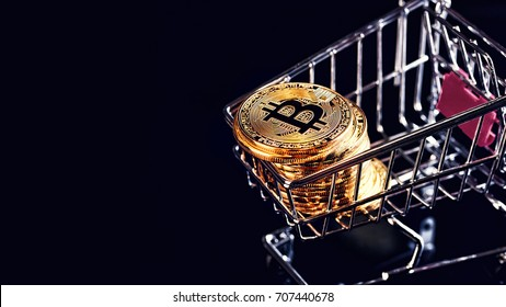 Bitcoins and New Virtual money concept.shopping carts full of Gold bitcoins with dark background.Golden coin with icon letter B.Mining or blockchain technology for cryptocurrency.