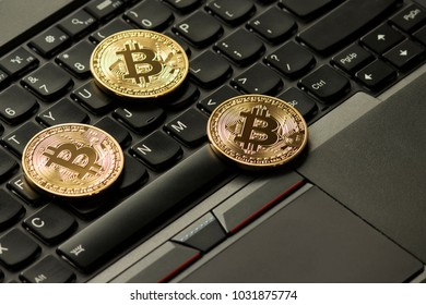 Bitcoins on Computer Keyboard