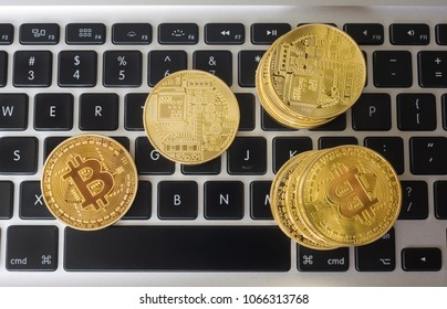 Bitcoins on the keyboard of a laptop