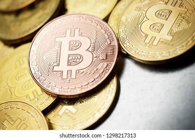 Bitcoins on a metal table.