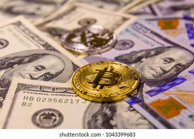 Bitcoins on a one hundred dollar bills
