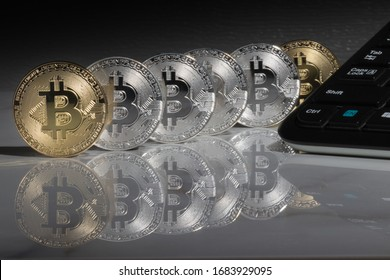 Bitcoins on the reflective marble desk, closeup. Cryptocurrency virtual money. Exchange, anonymous. Bitcoin is an open source web cash currency.