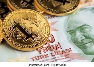 Bitcoins on Turkish Lira cryptocurrency against money from turkey Bitcoin coins on Turkish Lira banknotes money background with turkish lira and bitcoins turkish liras background Turkey cryptocurrency
