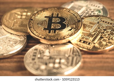 Bitcoins place on wooden background - Shutterstock ID 1059123113