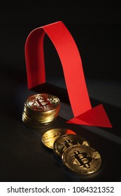 Bitcoins and red arrow showing down indicating negative trend, black background