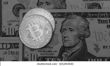 Bitcoins with US banknotes, golden bitcoin, silver bitcoin, bronze bitcoin. New virtual money.