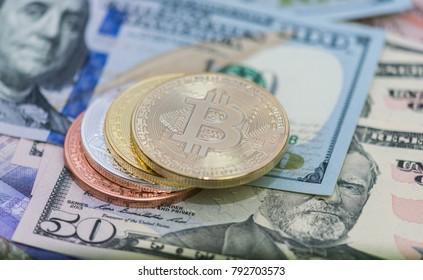 Bitcoins with US banknotes, golden bitcoin, silver bitcoin, bronze bitcoin