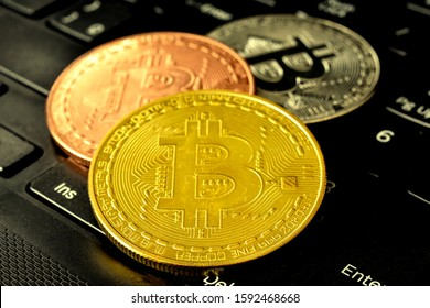 The Bitcoins virtual money or money of the future on a black computer keyboard