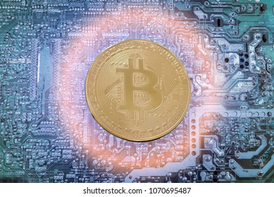 bitcon gold on the electronic circuit unlimited of business success concept blue light factoru background