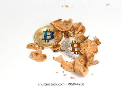 Bitcons - silver and golden and broken nutshell - symbol of crisis and drops on the market