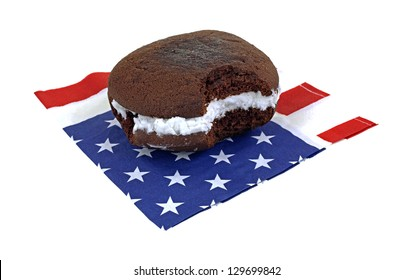 A bite of a delicious whoopie pie on a patriotic napkin.