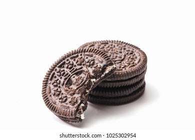 A bite on chocolate cookie and cream isolated on white