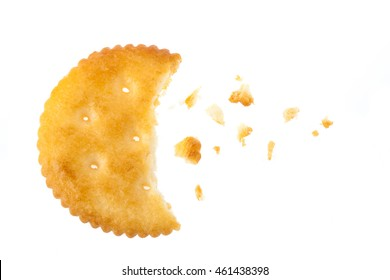A bite of a round cracker isolated on white background, top view