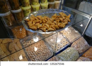 Bite sized baklava snacks in the medina of Fes, Morocco, Africa