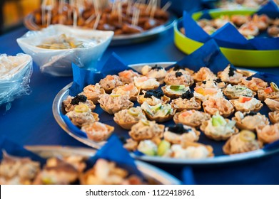 Bite sized snacks on large silver trays, appetizers or hors d'oeuvre at the buffet bar or self-service  restaurant as a starter, tapas or nibbles