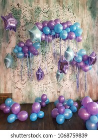 bithday party decoration with purple and blue baloons indoor