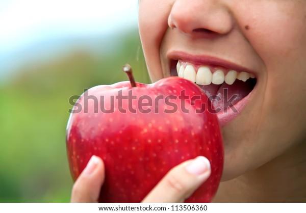 Biting an apple