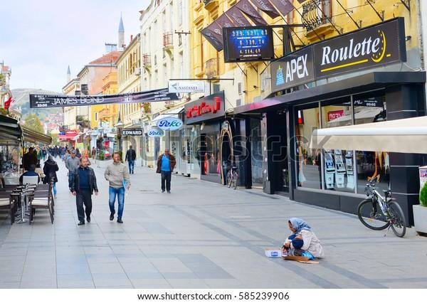 BITOLA, MACEDONIA - OCT 10, 2016: Beggars at Chirok Sokak street. Chirok Sokak is a main pedestrian street in the city center. Bitola, Republic of Macedonia
