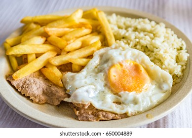 Bitoque of Portuguese cuisine, beef steak and egg with French fries